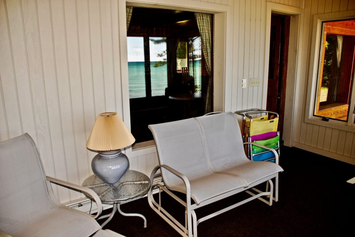 Comfortable enclosed porch overlooking Lake Michigan